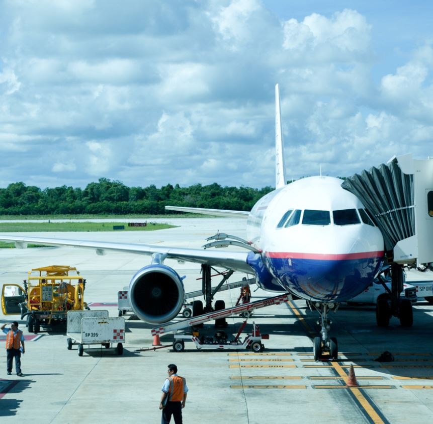Plane-loading-with-luggage-at-Cancun-airport