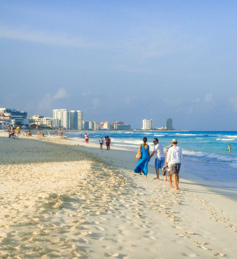 Travelers on beach in Cancun