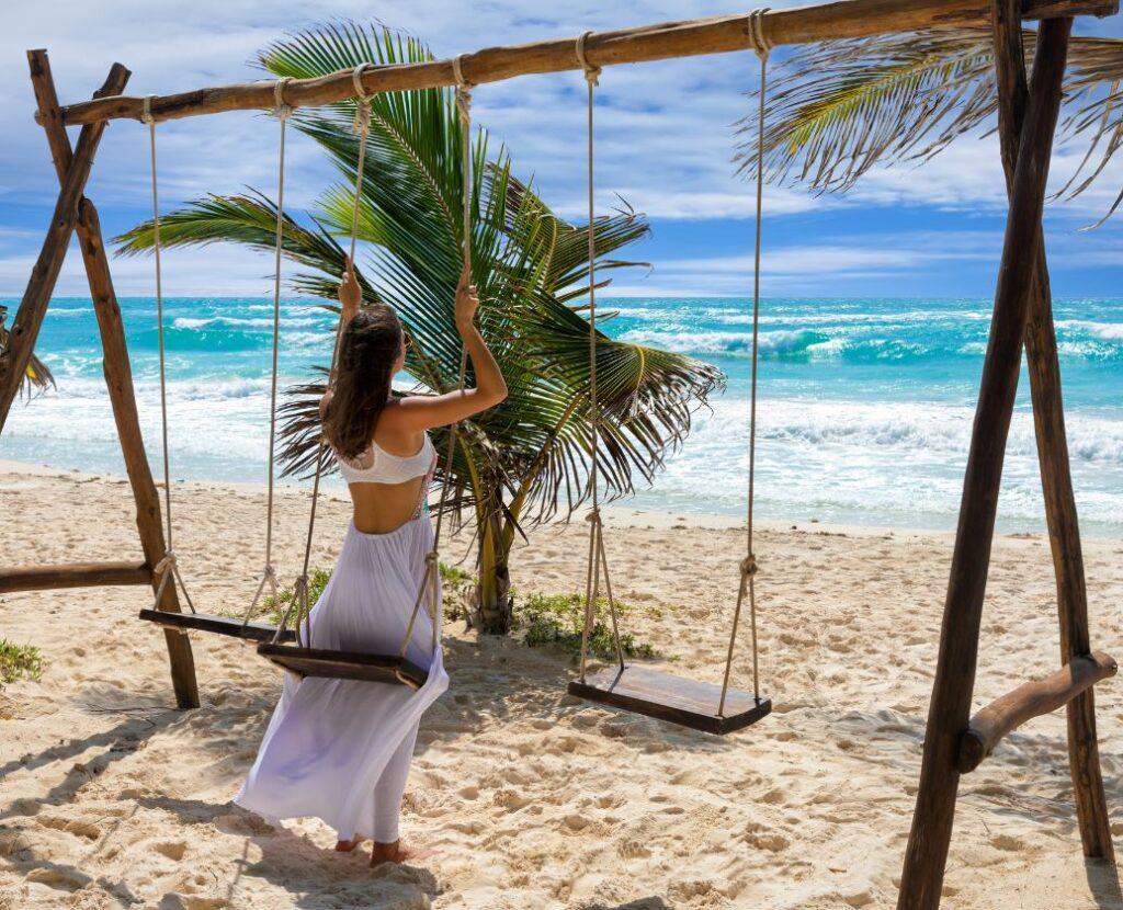 Tulum-Female-Tourist-on-Swing-at-Beach-1024x830-1