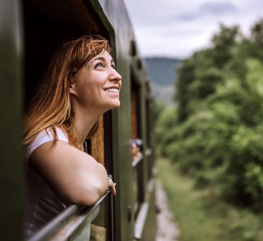 happy woman on train