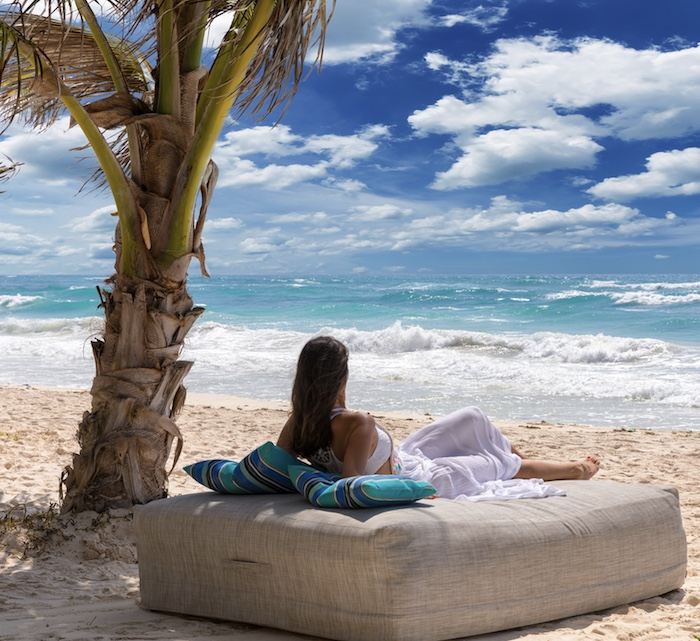 tourist Tulum beach waves