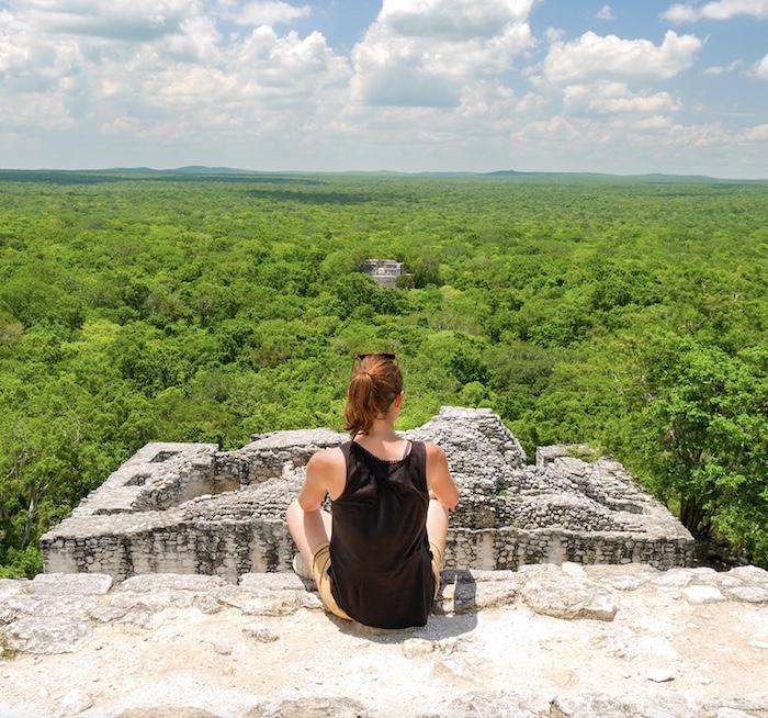 tourist at Calakmul Mayan ruins site