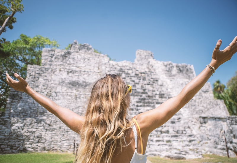tourist at ancient site in Cancun