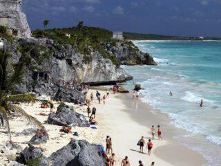tourists enjoy Maya Ruins Tulum beach