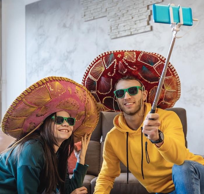tourists sombrero selfie stick