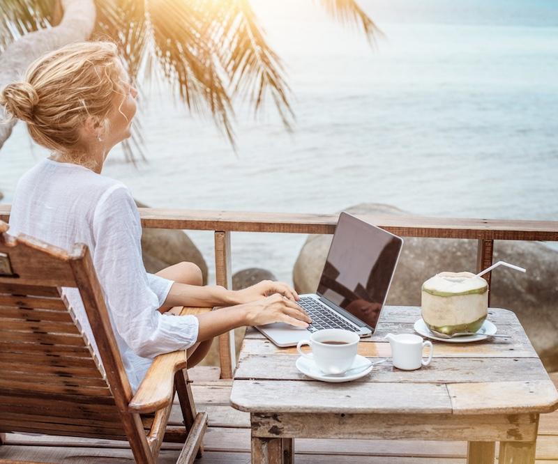 digital nomad laptop beach view