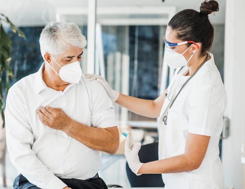 elderly Mexican man receiving vaccination