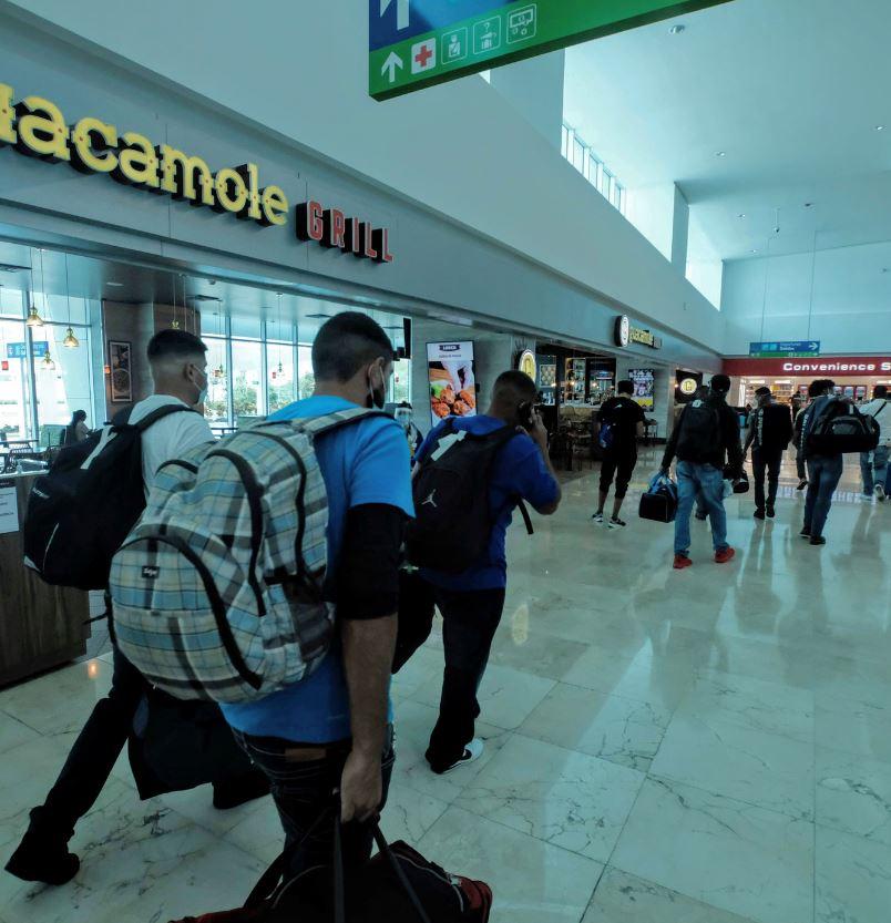 Cancun Airport passengers mask