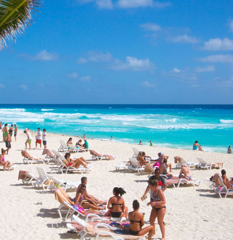 Cancun beach with tourists