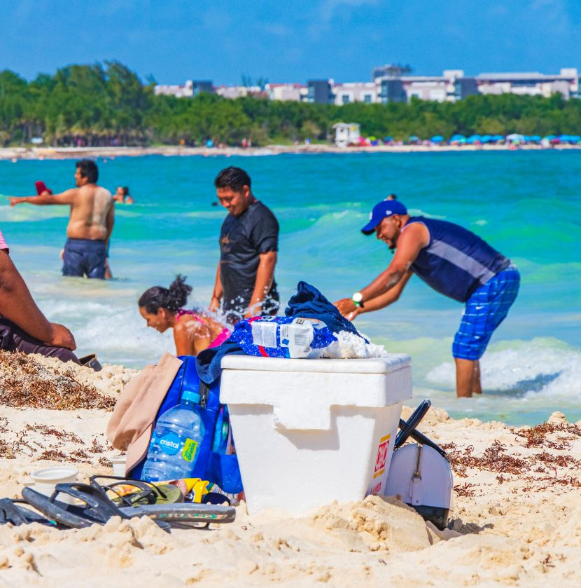 National Tourists on Beach in Cancun