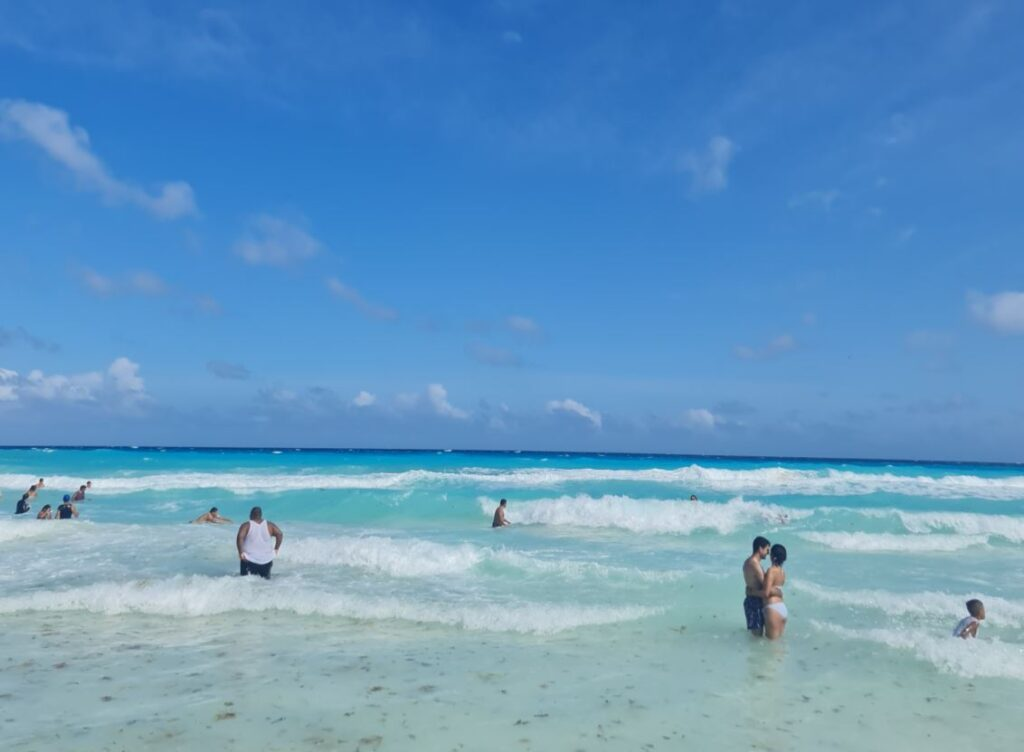 Tourists swimming in Cancun