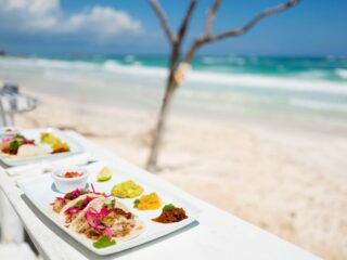 This favored beach-town is well loved for its laid back Mexican Caribbean vibes, the white sandy beaches that lead to breathtaking blue turquoise waters and of course, the many options to fuel your body, mind and soul. When I'm personally on vacation in Mexico, one of my favorite ways to fuel my body is with authentic tacos! The streets here are lined with different food trucks and taco stands, and no two are the same - I suggest going for a walk and a taco joint hop to find your own personal favs! Here are 5 top rated taco joints in Tulum to add to your must try list!